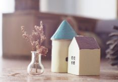 Close-Up Of House Figurines On Table At Home